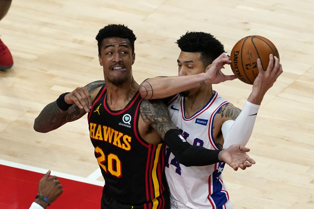 Philadelphia 76ers forward Danny Green (14) and Atlanta Hawks forward John Collins (20) battle for the ball during the first half of an NBA basketball...