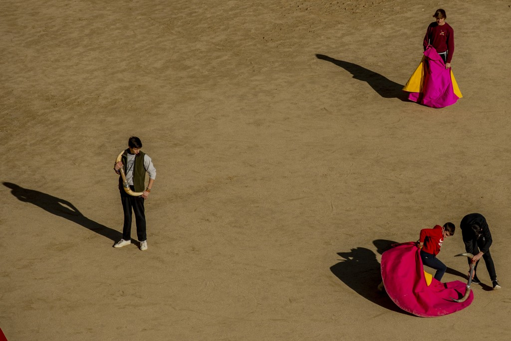 Pupils practice with their capes at the Bullfighting School at Las Ventas bullring in Madrid, Spain, Tuesday, Dec. 29, 2020. Holding the red cape outs...