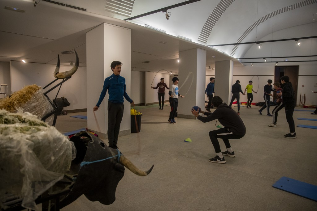 Pupils exercise in a gym at the Bullfighting School at Las Ventas bullring in Madrid, Spain, Tuesday, Dec. 29, 2020. They exercise in a small gym, run...