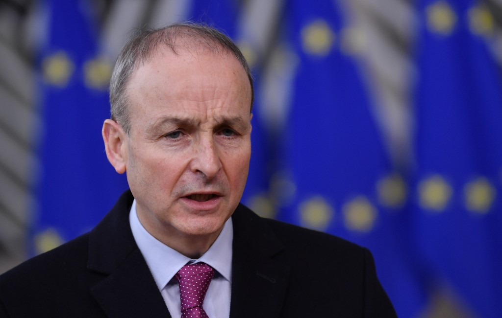 FILE - In this file photo dated Thursday, Dec. 10, 2020, Ireland's Prime Minister Micheal Martin speaks as he arrives at the European Council building...