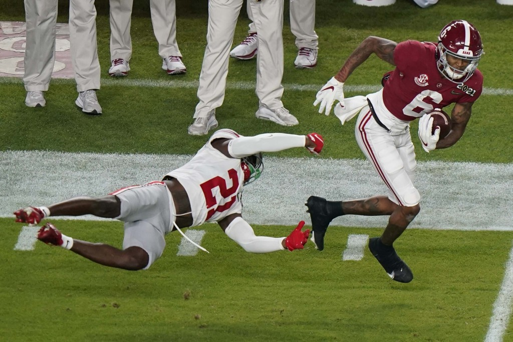Alabama wide receiver DeVonta Smith runs past Ohio State cornerback Marcus Williamson during the first half of an NCAA College Football Playoff nation...