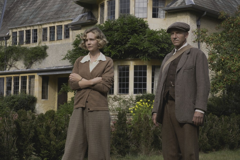 """This image released by Netflix shows Carey Mulligan, left, and Ralph Fiennes in a scene from """"The Dig.""""  (Larry Horricks/Netflix via AP)"""