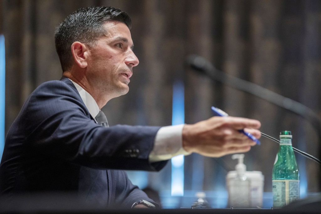 FILE - In this Sept. 23, 2020, file photo, acting Secretary of Homeland Security Chad Wolf testifies before the Senate Homeland Security and Governmen...