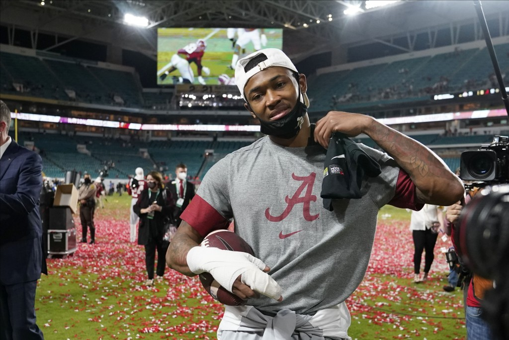 Alabama wide receiver DeVonta Smith leaves the field after their win against Ohio State in an NCAA College Football Playoff national championship game...