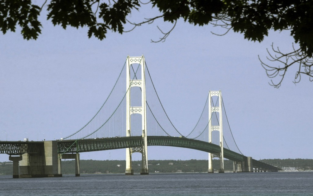 FILE - This July 19, 2002, file photo, shows the Mackinac Bridge that spans the Straits of Mackinac from Mackinaw City, Mich. Supporters and opponents...