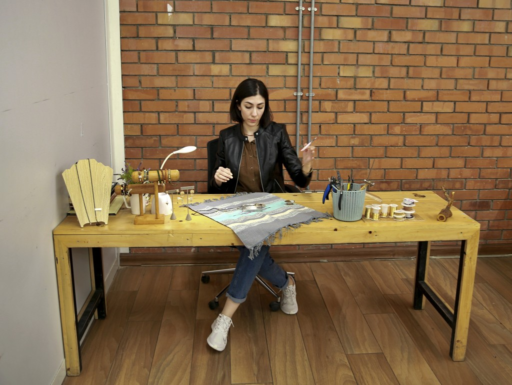 Mariam Khzarjian works on her jewelry in Baghdad, Iraq, Saturday, Dec. 5, 2020. In late 2018 Khzarjian decided to start her own home-based business co...