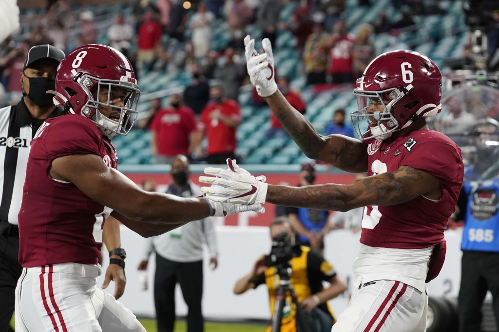 Alabama wide receiver John Metchie III, left, congratulates wide receiver DeVonta Smith, after Smith scored a touchdown against Ohio State during the ...