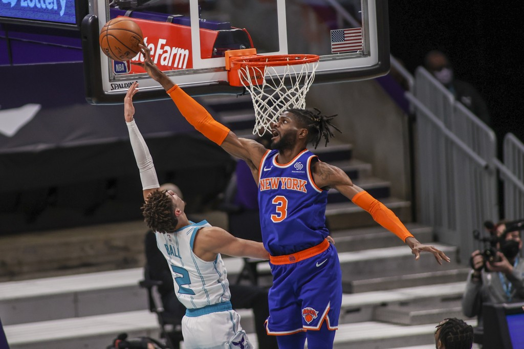 New York Knicks center Nerlens Noel (3) blocks a shot by Charlotte Hornets guard LaMelo Ball (2) in the first quarter of an NBA basketball game in Cha...
