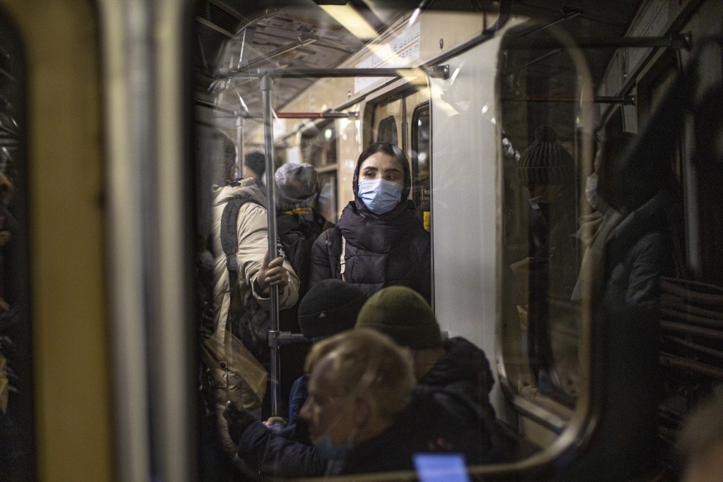 A woman wearing a face mask to help curb the spread of the coronavirus rides a subway car in Moscow, Russia, Monday, Jan. 11, 2021. Russia has continu...