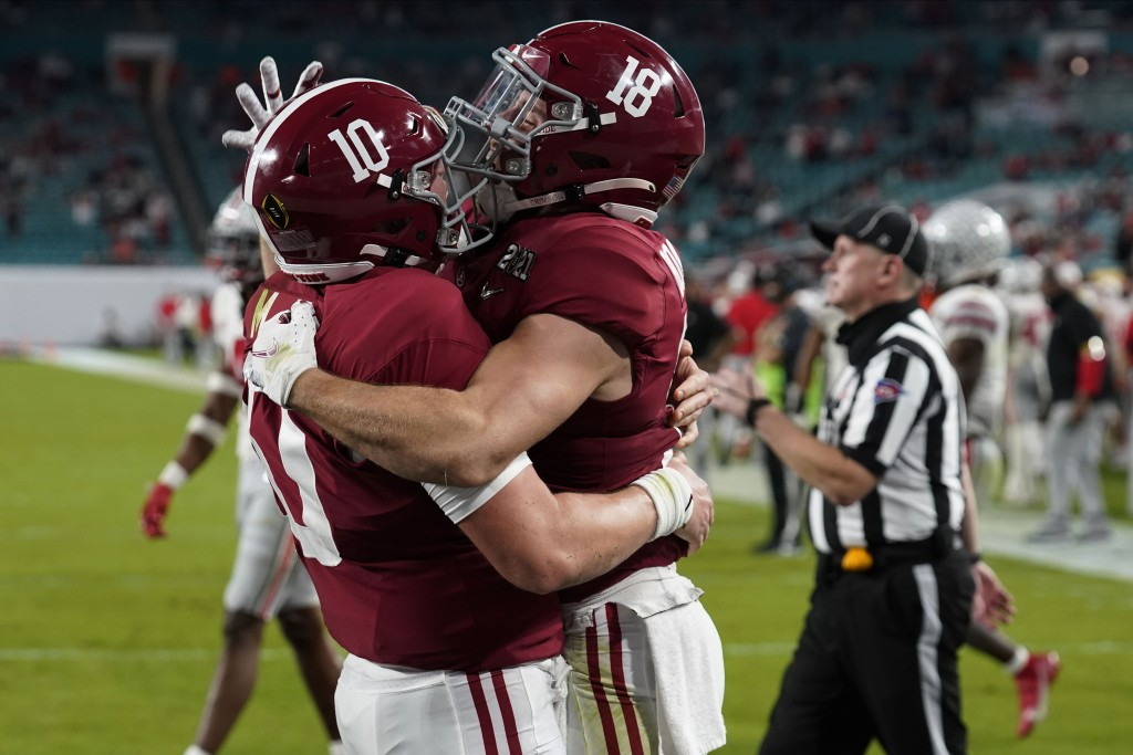Alabama wide receiver Slade Bolden, right, celebrates after scoring a touchdown with quarterback Mac Jones during the second half of an NCAA College F...