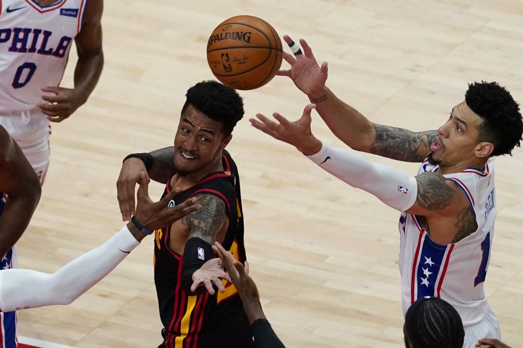 Atlanta Hawks forward John Collins (20) and Philadelphia 76ers forward Danny Green (14) battle for a rebound during the first half of an NBA basketbal...