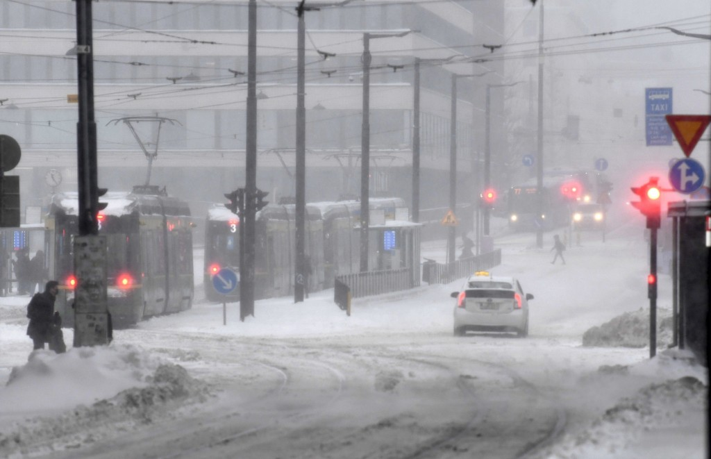 A thick layer of snow covers the streets of central Helsinki, Finland, making travel difficult on Tuesday Jan. 12, 2021. The heavy snowfall is predict...