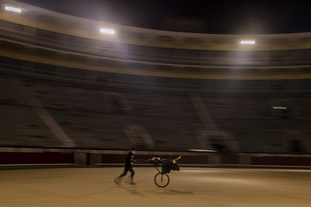 A pupil practices with a 'Carreton' (bulls horns attached to a metal frame with wheels) at the Bullfighting School at Las Ventas bullring in Madrid, S...