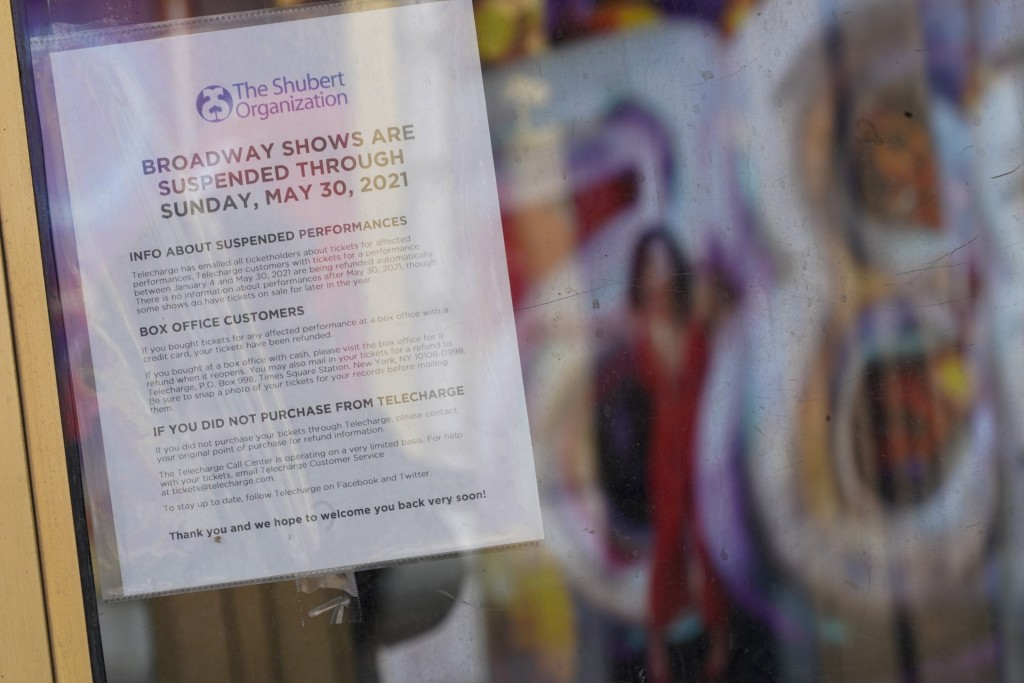 A sign hanging at the box office of a Theatre advises patrons that the Broadway shows are suspended, Sunday, Jan. 10, 2021, in the Hell's Kitchen neig...