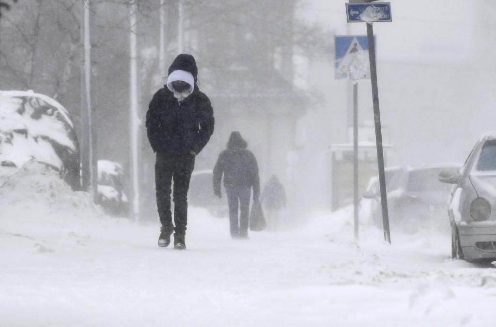 A thick layer of snow covers the streets of central Helsinki, Finland, making all kinds of travel difficult on Tuesday Jan. 12, 2021. The heavy snowfa...