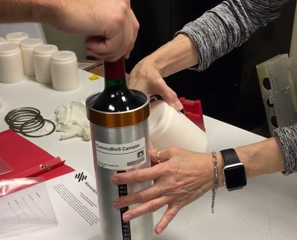 FILE - In this Saturday, Nov. 2, 2019 photo provided by Space Cargo Unlimited, researchers from the company prepare bottles of French red wine to be f...