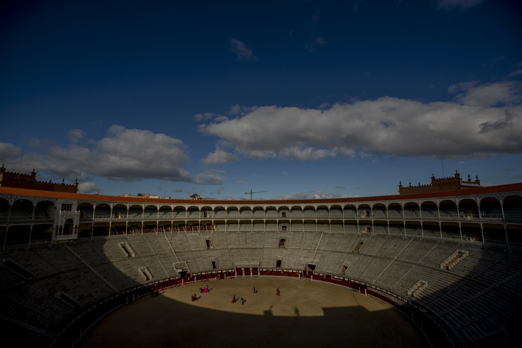 Pupils perform with their capes at the Bullfighting School at Las Ventas bullring in Madrid, Spain, Tuesday, Dec. 29, 2020. Las Ventas is one of the m...