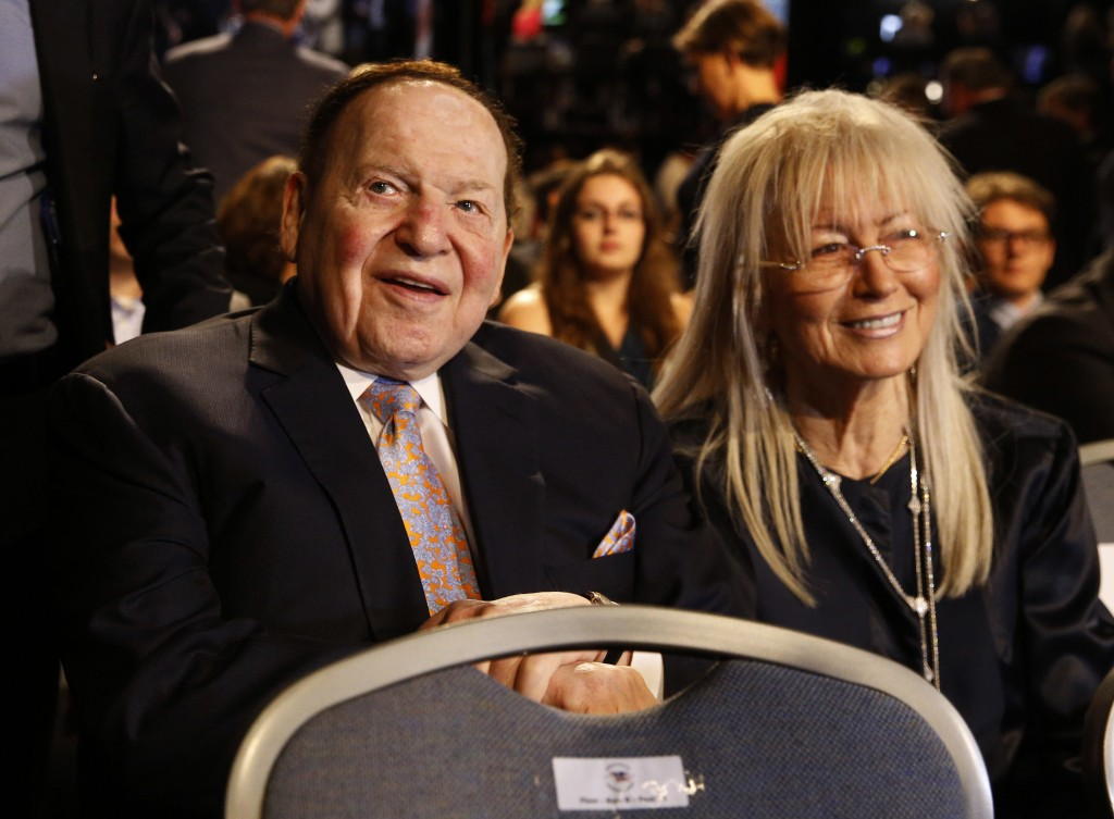 FILE - In this Sept. 26, 2016 file photo, Chief Executive of Las Vegas Sands Corporation Sheldon Adelson sits with his wife Miriam waits for the presi...