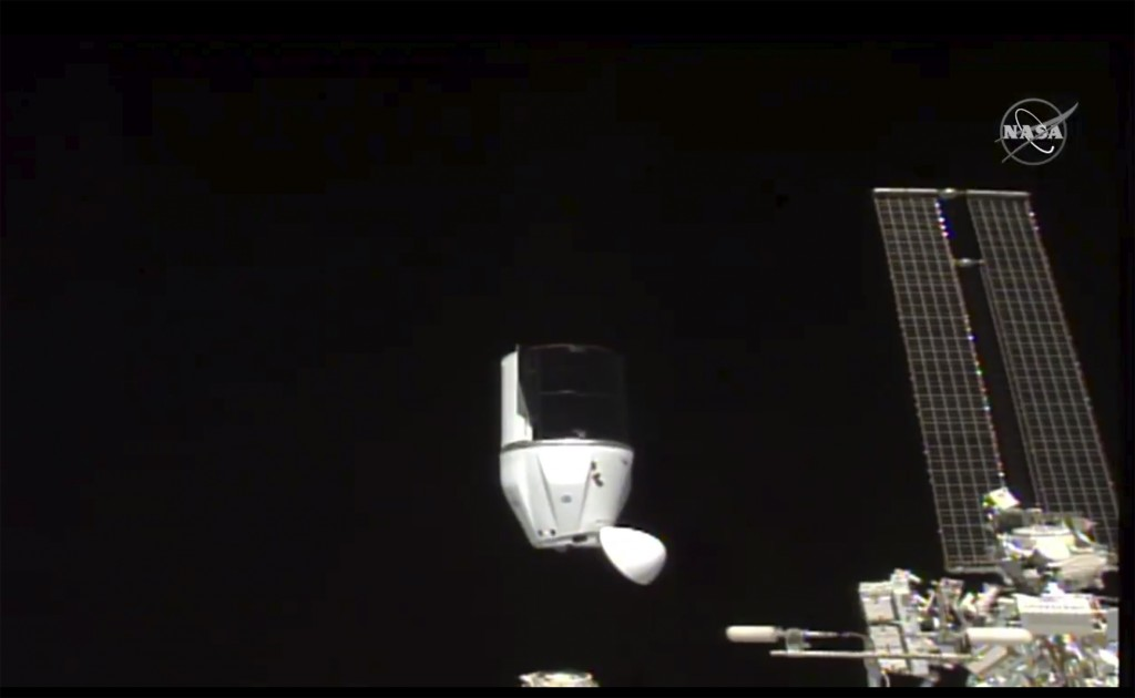 This photo provided by NASA shows SpaceX's Dragon undocking from International Space Station on Tuesday, Jan. 12, 2021.  SpaceX's Dragon cargo capsule...