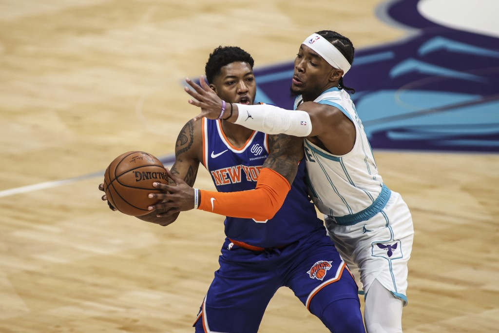 Charlotte Hornets guard Devonte' Graham, right, disrupts New York Knicks guard Elfrid Payton in the first quarter of an NBA basketball game in Charlot...