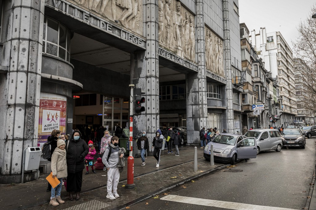 Students of the school Athenee Leonie de Waha and relatives leave at the end of their classes in Liege, Belgium, Tuesday, Jan. 12, 2021. Fed up with t...