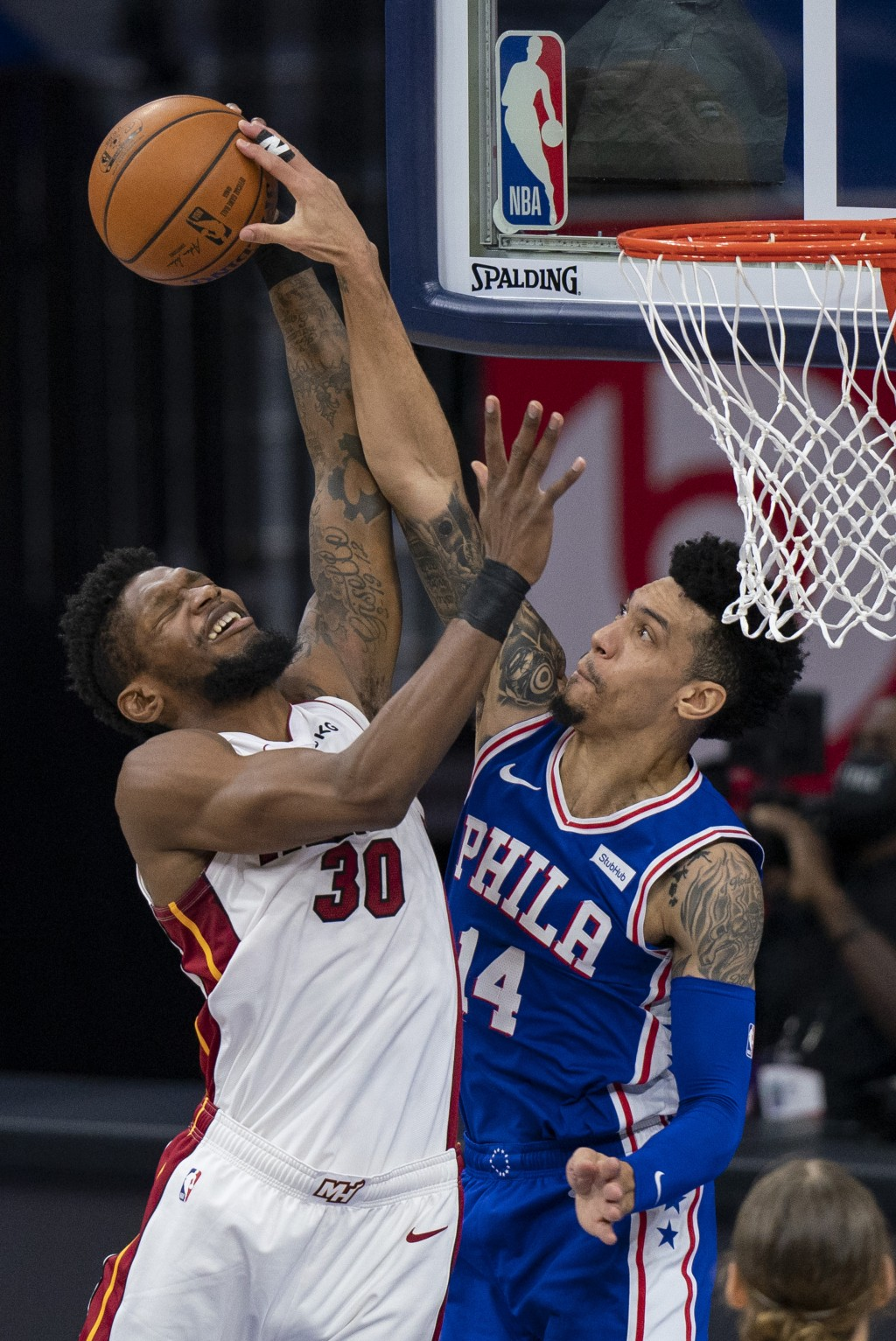 Philadelphia 76ers' Danny Green, right, blocks a shot by Miami Heat's Chris Silva during the first half of an NBA basketball game Tuesday, Jan. 12, 20...