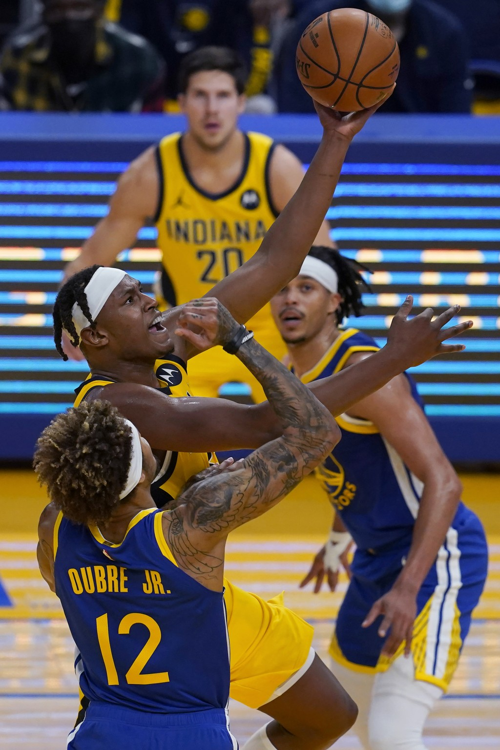 Indiana Pacers center Myles Turner, middle left, shoots next to Golden State Warriors guard Kelly Oubre Jr. (12) during the first half of an NBA baske...