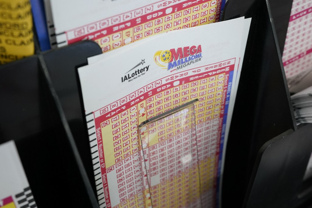 Blank forms for the Mega Millions lottery sit in a bin at a local grocery store, Tuesday, Jan. 12, 2021, in Des Moines, Iowa. Lottery players have a c...