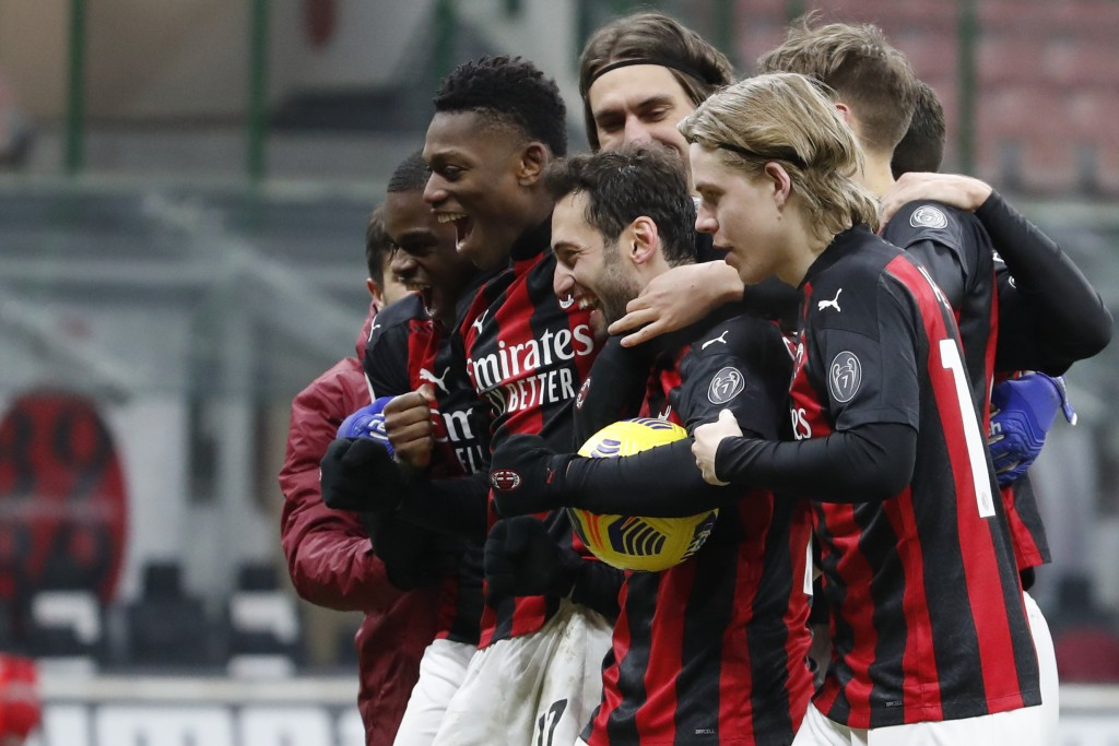 AC Milan players celebrate after defeating Torino in their Italian Cup round of 16 soccer match between AC Milan and Torino at the San Siro stadium, i...