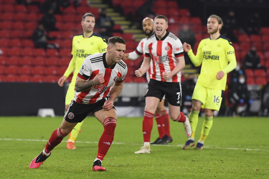 Sheffield United's Billy Sharp celebrates after scoring his side's first goal during the English Premier League soccer match between Sheffield United ...