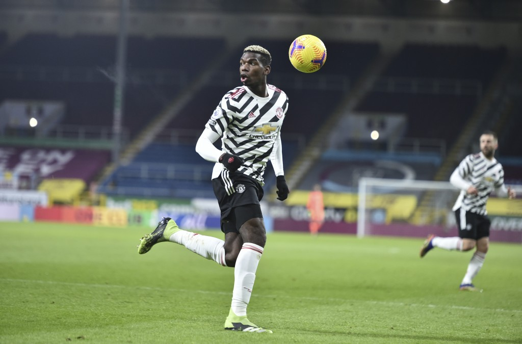 Manchester United's Paul Pogba, controls the ball during the English Premier League soccer match between Burnley and Manchester United in Burnley, Eng...