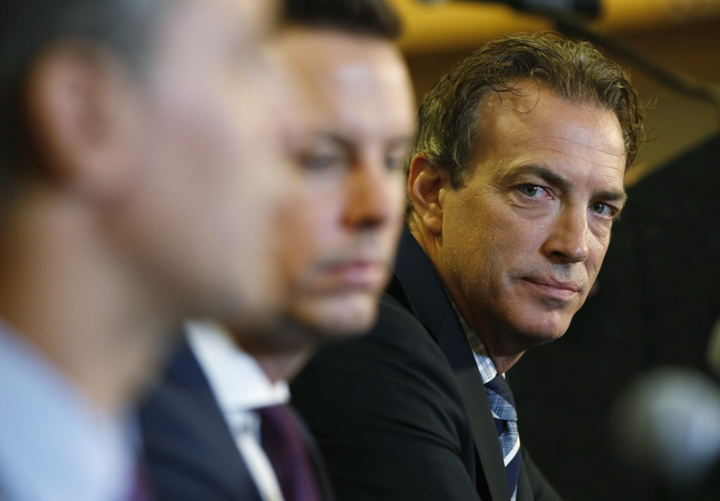 FILE - Colorado Avalanche general manager Joe Sakic, right, looks on during a news conference to introduce Jared Bednar as the NHL hockey club's new c...