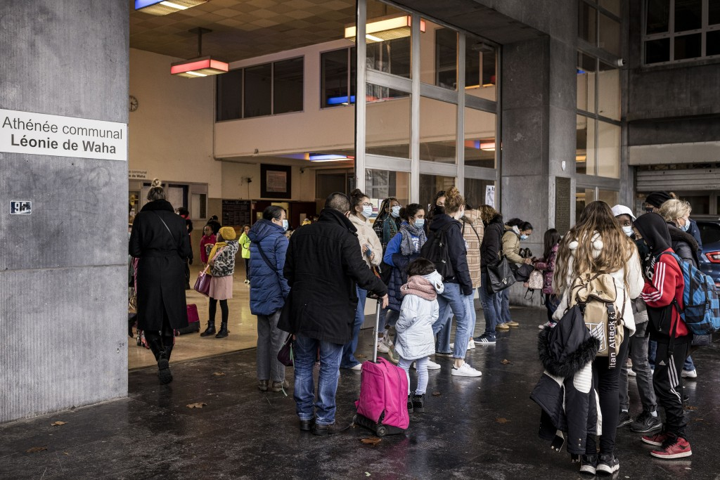 Students of the school Athenee Leonie de Waha leave at the end of their classes in Liege, Belgium, Tuesday, Jan. 12, 2021. Fed up with the COVID-19 re...