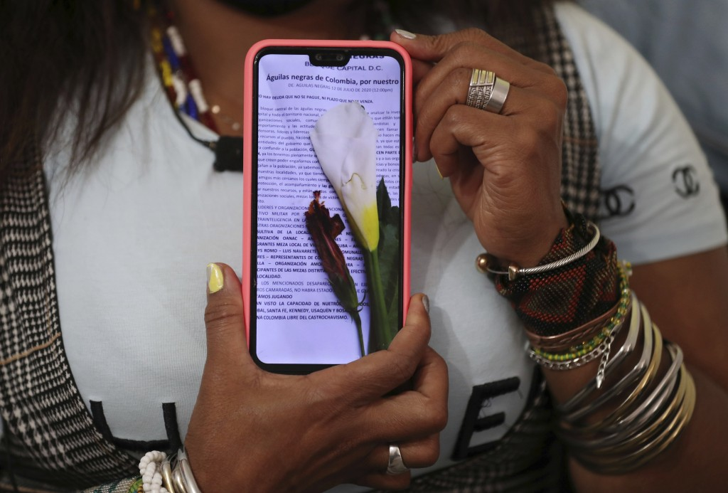 Community leader Luz Nelly Santana shows one of the many death threats she has received in Bogota, Colombia, Thursday, Dec. 17, 2020. The Afro-Colombi...