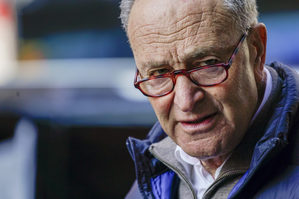 Senate Minority Leader Chuck Schumer, D-N.Y., speaks to reporters during a news conference, Tuesday, Jan. 12, 2021, in New York. (AP Photo/Mary Altaff...