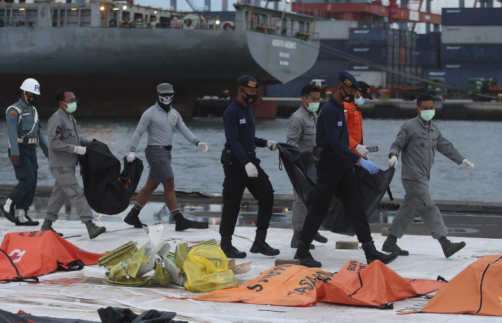 Debris found in the waters around Sriwijaya Air passenger jet crash site is brought to shore by recovery teams at the search and rescue command center...
