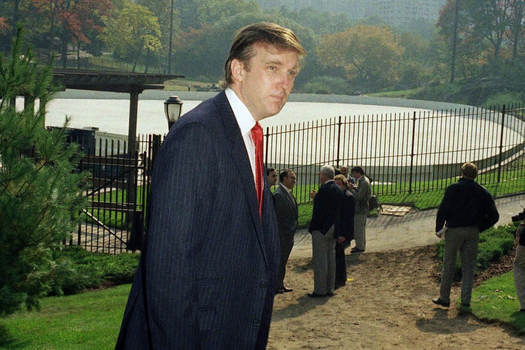 FILE - In this Oct. 23, 1986, file photo, Donald Trump is photographed in New York's Central Park, in front of the Wollman Skating Rink, which he offe...