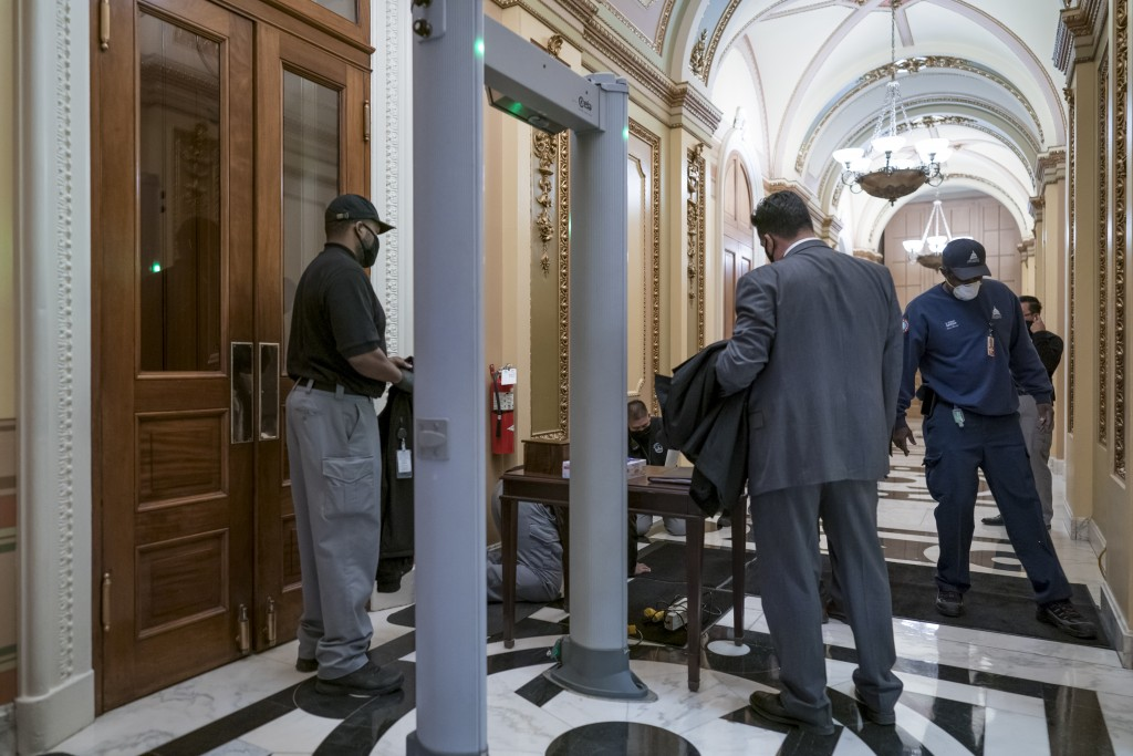 Metal detectors for lawmakers are installed in the corridor around the House of Representatives chamber after a mob loyal to President Donald Trump st...