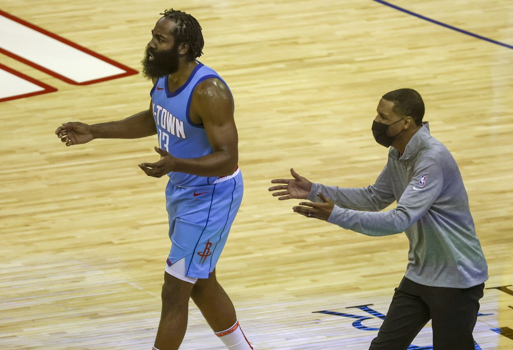 Houston Rockets guard James Harden (13) and coach Stephen Silas, right, react after a play during the second quarter against the Los Angeles Lakers in...