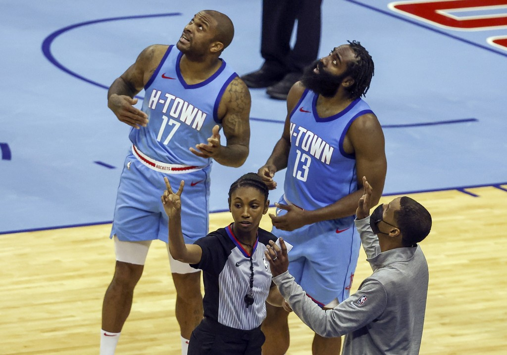 Houston Rockets forward P.J. Tucker (17) and guard James Harden (13) and Rockets coach Stephen Silas, front right, watch a replay after a call during ...