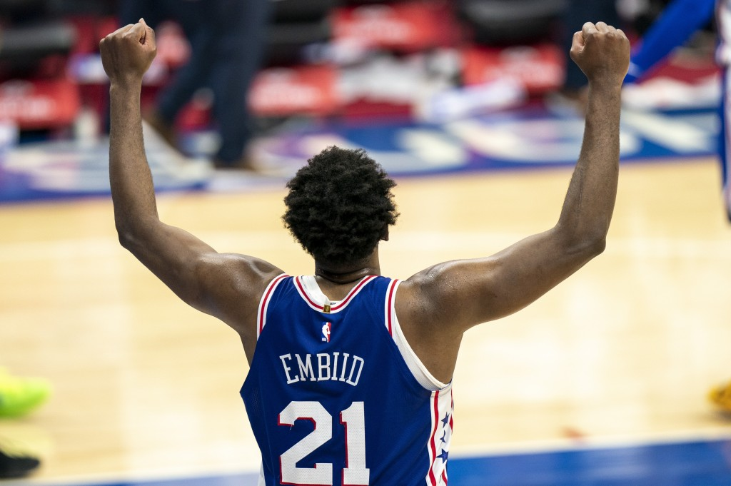 Philadelphia 76ers' Joel Embiid reacts to the 137-134 overtime win in an NBA basketball game against the Miami Heat, Tuesday, Jan. 12, 2021, in Philad...