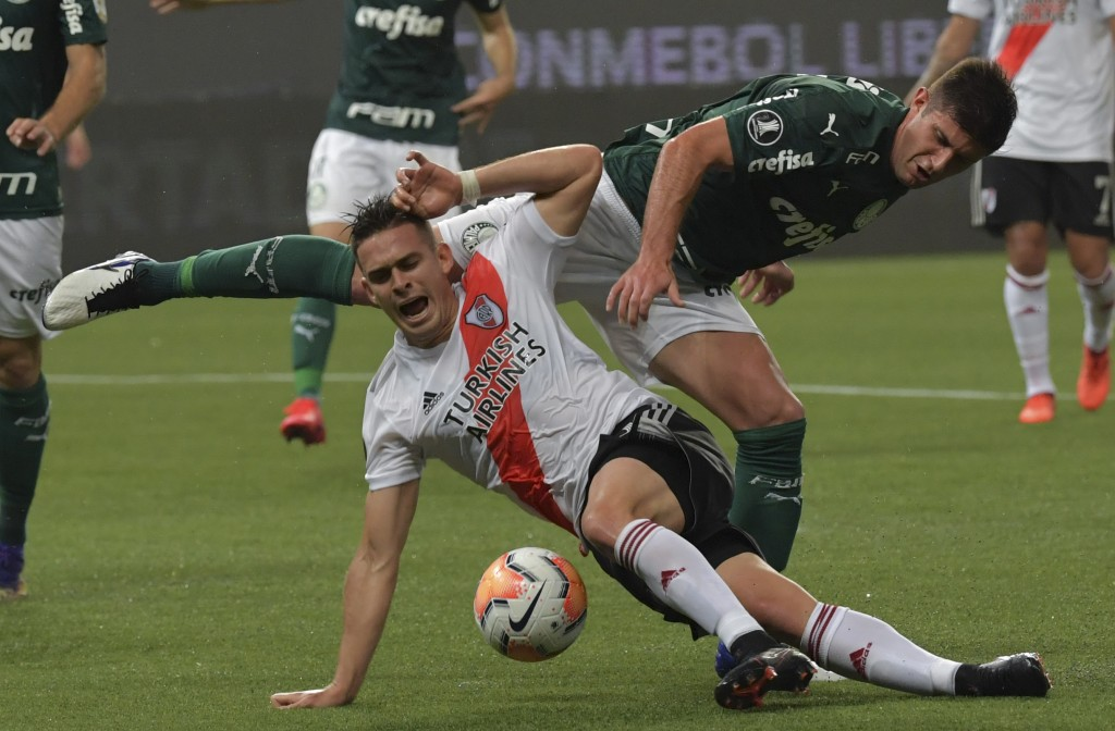 Rafael Santos Borre of Argentina's River Plate, front, and Kuscevic of Brazil's Palmeiras battle for the ball during a Copa Libertadores semifinal sec...