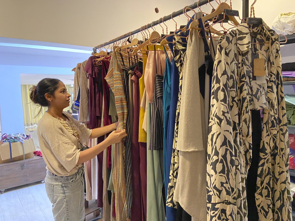 Designer Suman Bhat browses through a display of her collections at Panjim in Goa, India, Dec.24, 2020. Sitting at home last summer during the lockdow...
