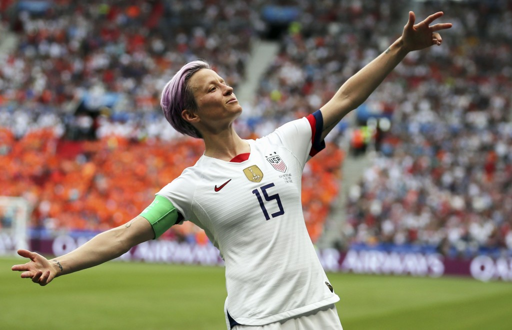 FILE - In this July 7, 2019 file photo, United States' Megan Rapinoe celebrates after scoring the opening goal from the penalty spot during the Women'...