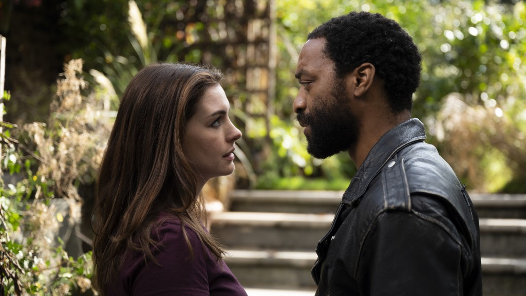 "This image released by HBO Max shows Anne Hathaway and Chiwetel Ejiofor in a scene from ""Lockdown."" (Susie Allnutt/HBO Max via AP)"
