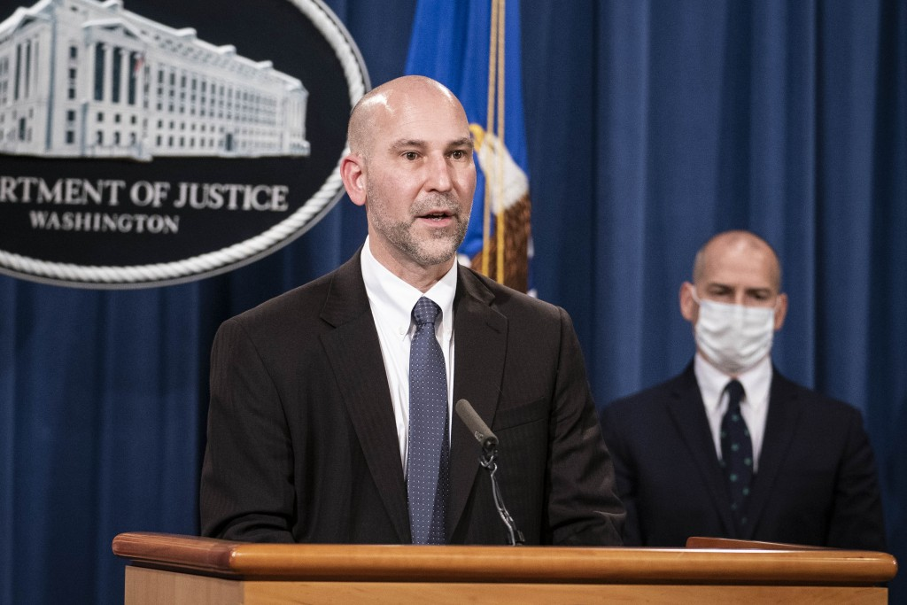Steven D'Antuono, head of the Federal Bureau of Investigation (FBI) Washington field office, speaks as acting U.S. Attorney Michael Sherwin, right, li...