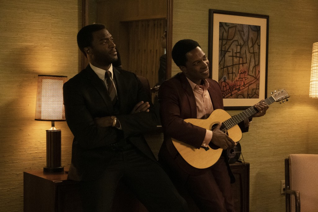 "This image released by Amazon Studios shows Aldis Hodge, left, and Leslie Odom Jr. in a scene from ""One Night in Miami."" (Patti Perret/Amazon Studios ..."