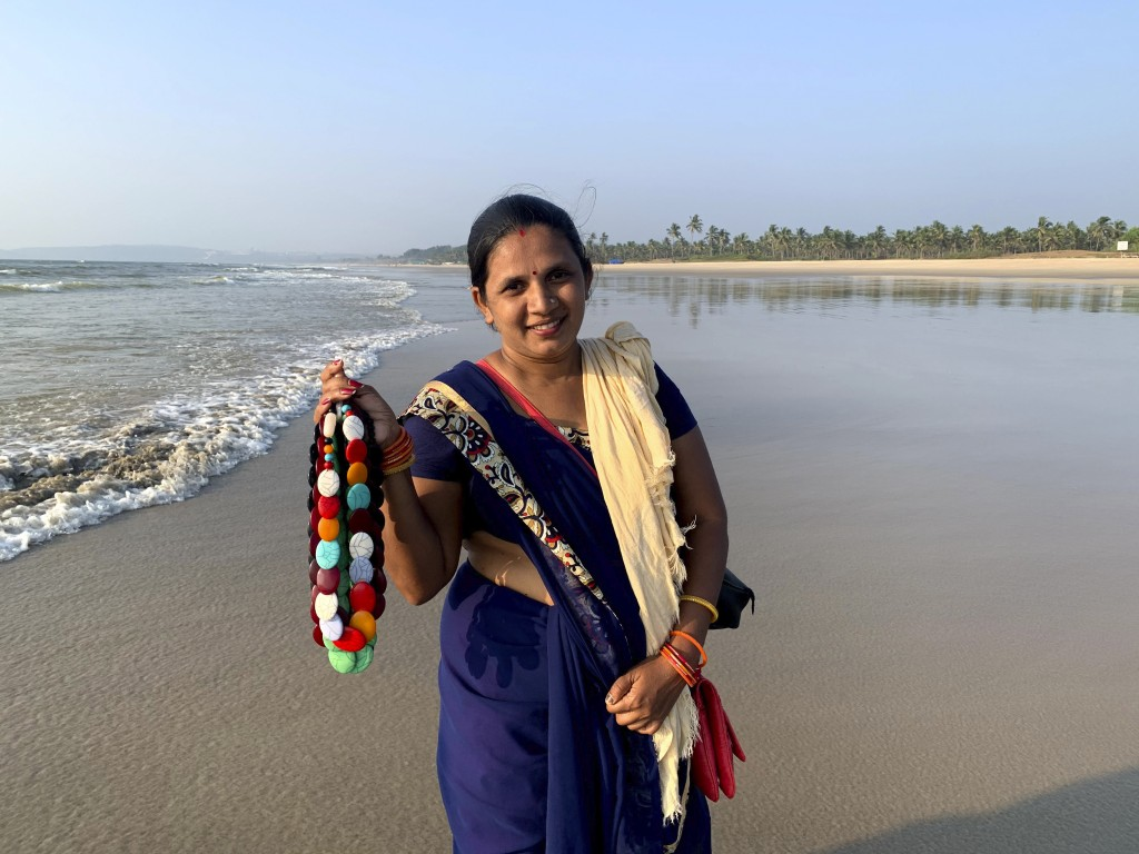 Seema Rajgarh, 37, hawks jewelry made of beads and stones on nearly deserted Utorda beach in South Goa, India,, Dec.16, 2020. On good days during the ...