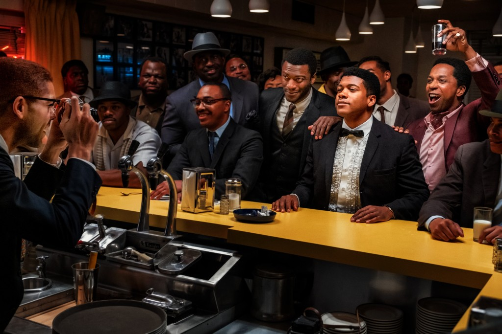 "This image released by Amazon Studios shows, from right, Leslie Odom Jr., Eli Goree and Aldis Hodge in a scene from ""One Night in Miami."" (Patti Perre..."