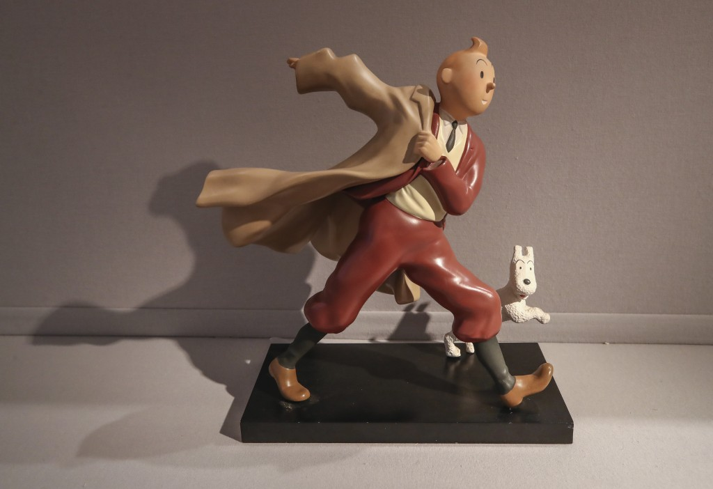 "A 1988 polychrome resin sculpture of the comic character Tintin and his dog snowy from the 1941 ""The Crab with the Golden Claws"" album drawn by Belgia..."